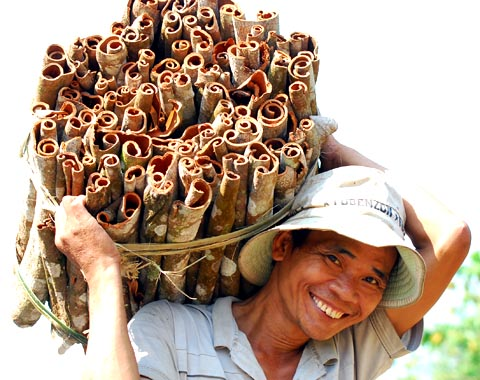 farmer smiling with cinnamon